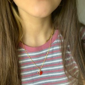 gold plated necklace w/ half filled red heart